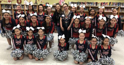 cheerleaders with board member