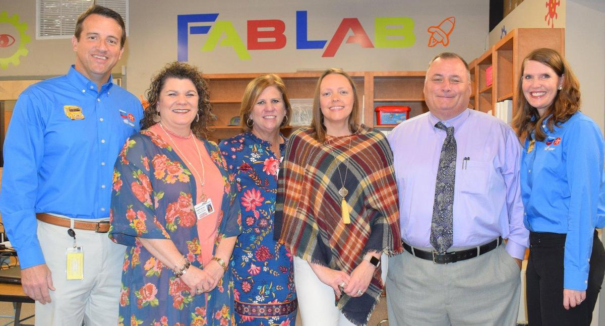 Natalie MccKinney Grant winner with Chevron, principal, asst. supt and supt.