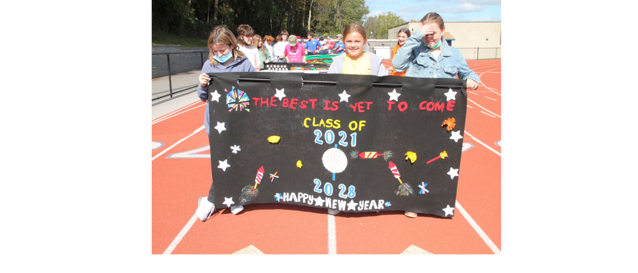 students walking with banner