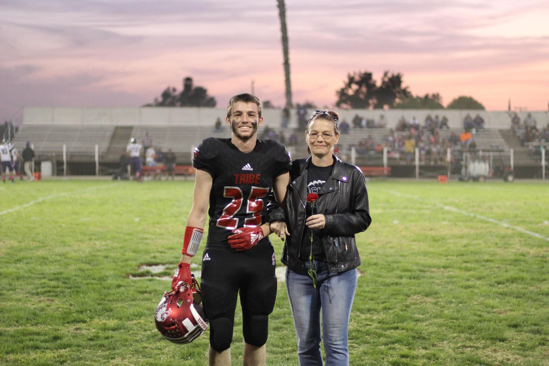 Senior football player Will Downham and his escort.