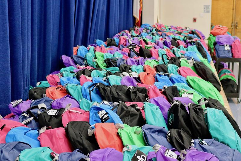 Donated backpacks ready for distribution