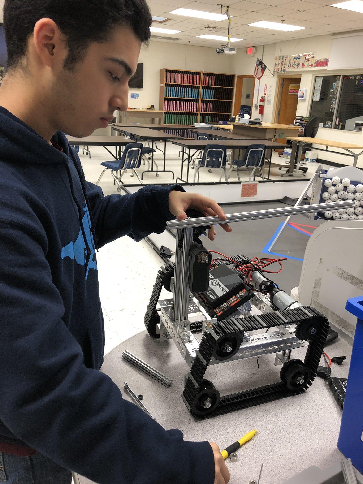 student working on robotics project