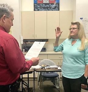 board president being sworn in