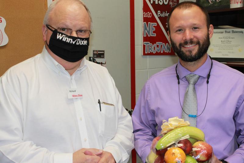 NEHS Principal Joshua Herrington and Winn-Dixie Store Manager, Mr. Richard McDonald