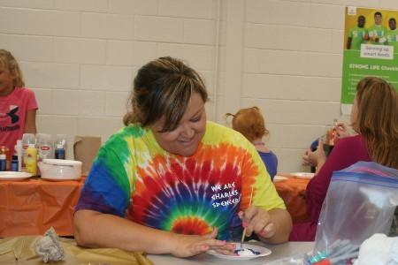 Mrs. Stone painting her rock for Tifton Rocks.