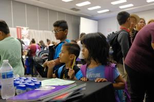 Backpack giveaway event photos