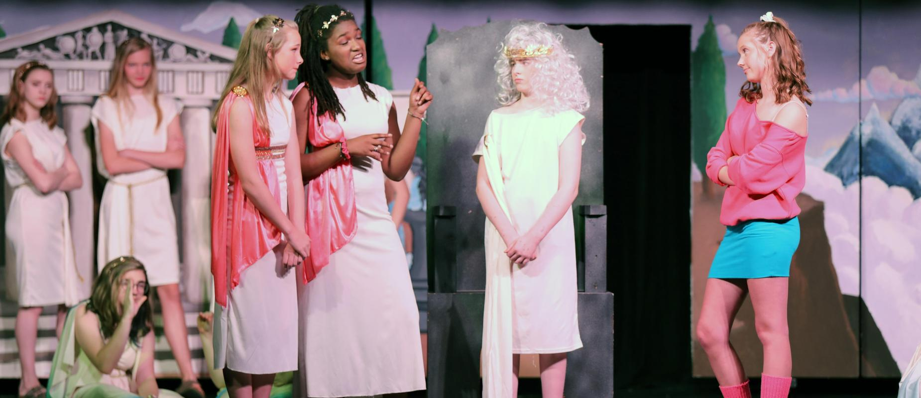 Xanadu actresses in goddess outfits talk to Greek god on stage