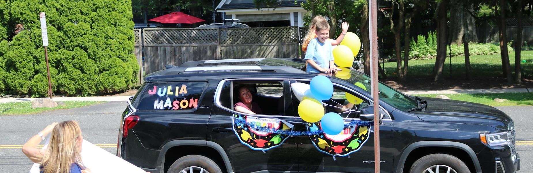 Photo of Franklin 5th grader and family during Grade 5 Clap Out Car Parade.