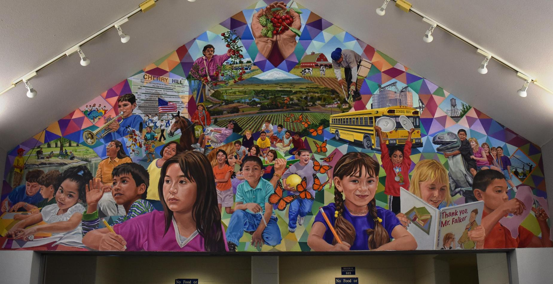 This is a mural created to represent Granger.  There are kids learning, playing, and dinosaurs