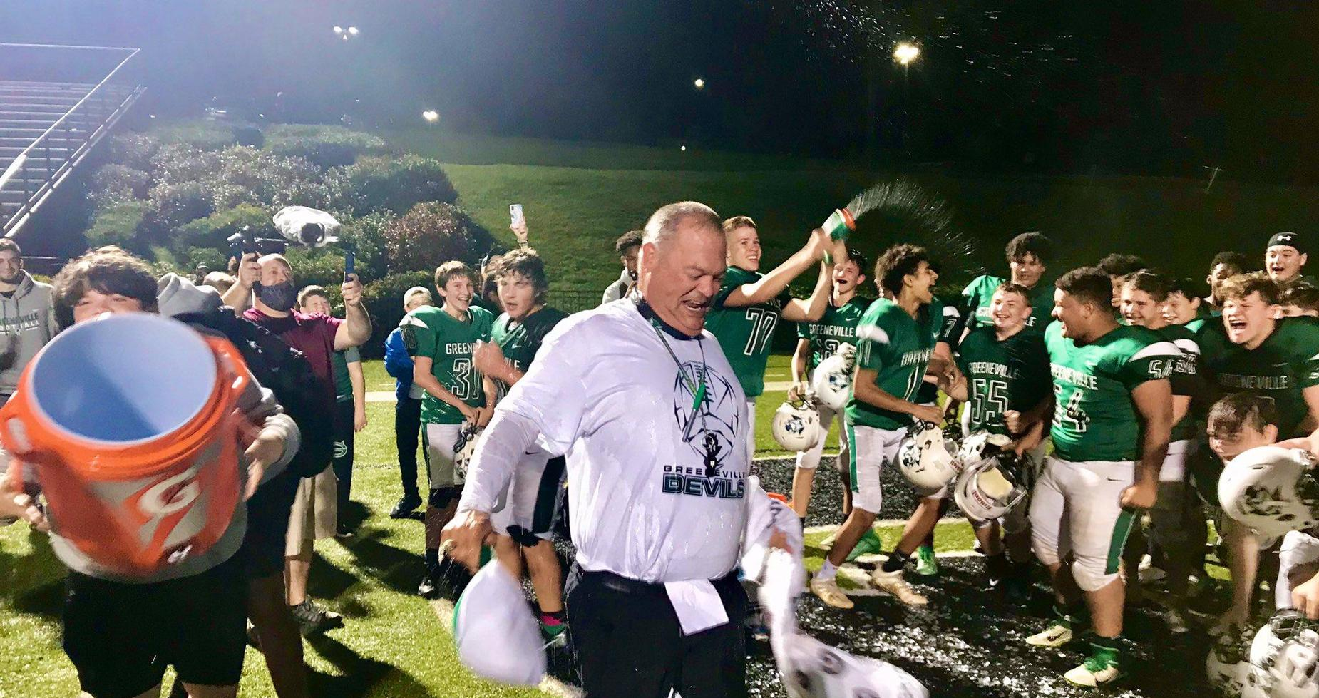 coach gets gatorade dumped on him after win