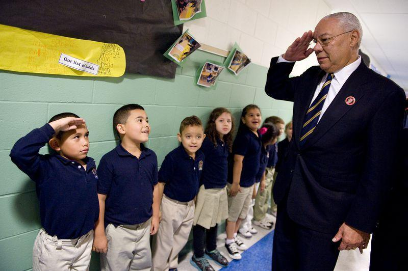 Students saluting Colin Powell