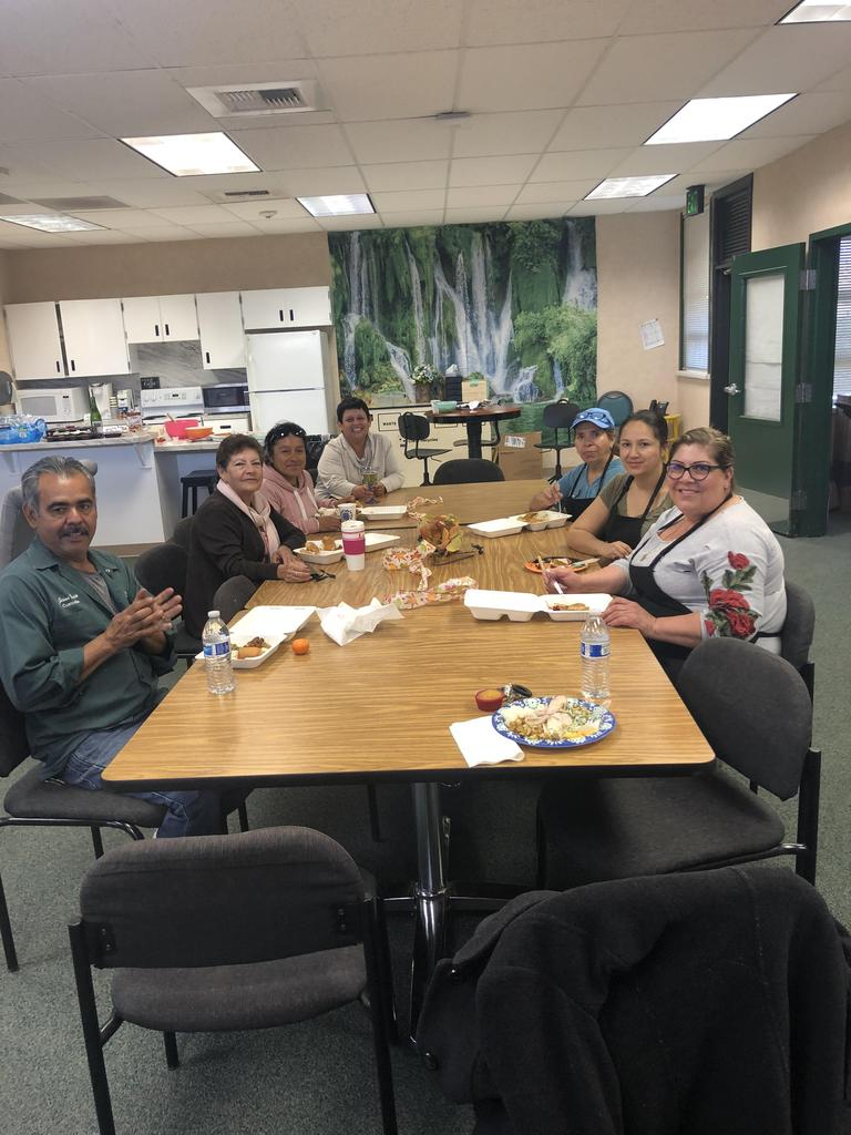service staff enjoys Thanksgiving lunch