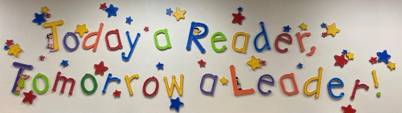 Today a Reader Tomorrow a Leader in colorful letters with stars