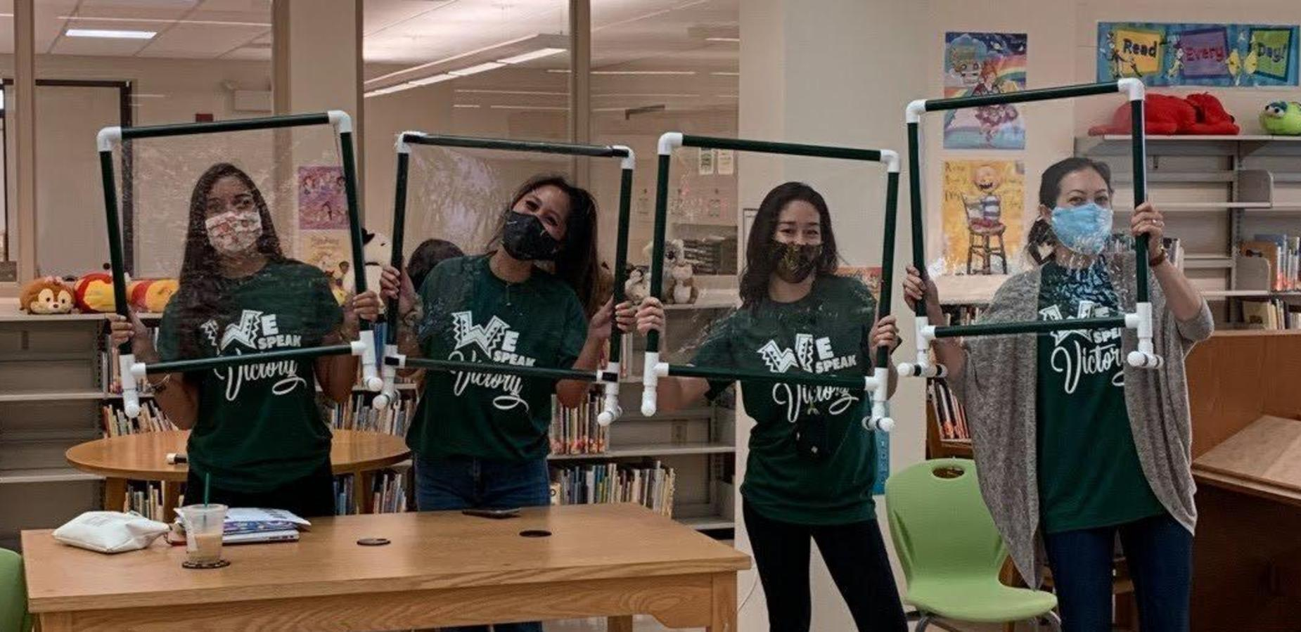 Teachers display their DIY sneeze guards
