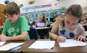 Fifth graders in Matthew Cognetti's class at Washington School write letters to themselves which Cognetti will set aside and mail to each of them when they graduate from high school, a tradition Cognetti began 16 years ago as a first year teacher.