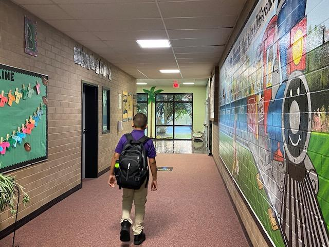A student arrives for school