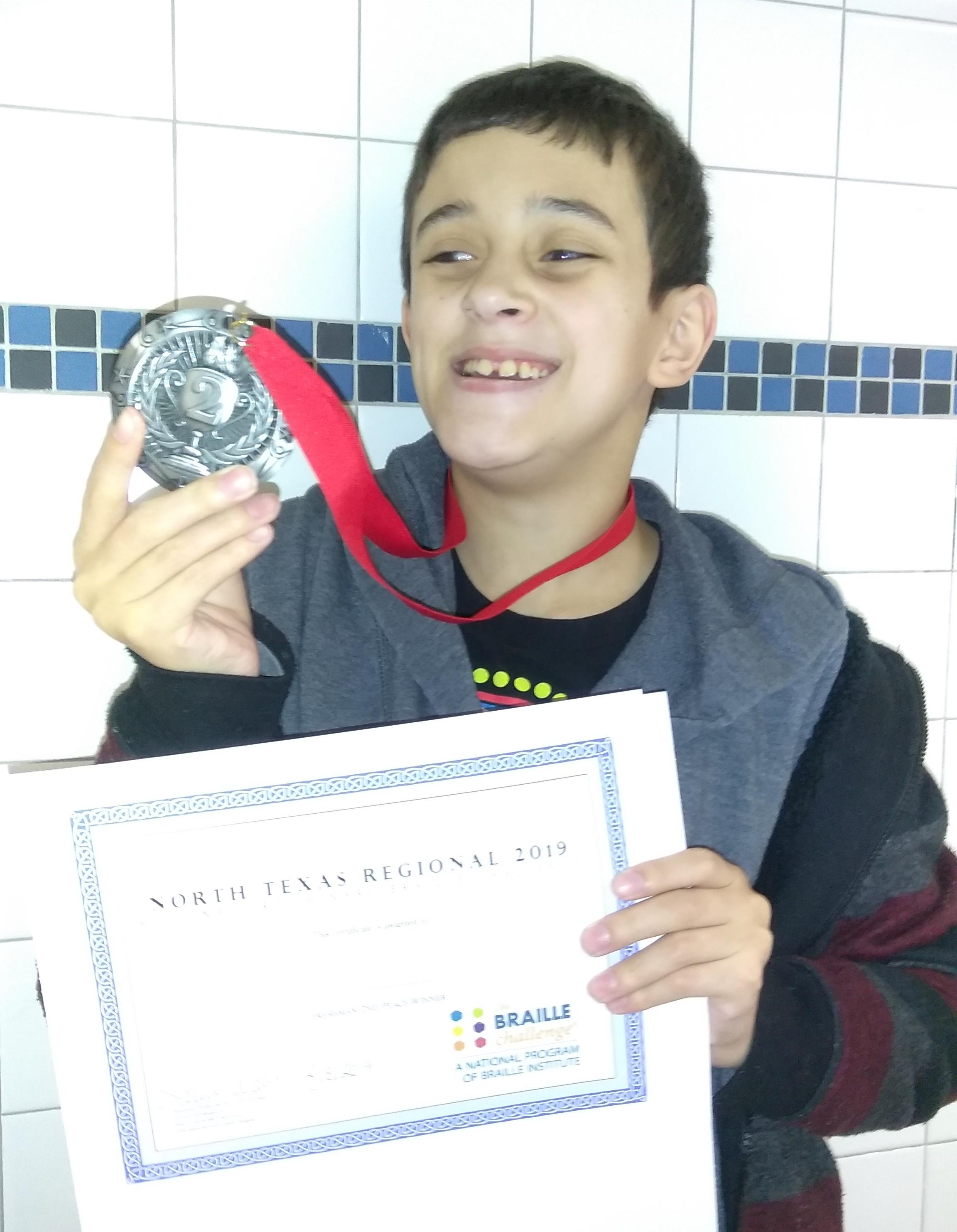 Brewer Middle School seventh grader Alex Flores recently won second place in the region in the freshman division of the Braille Challenge.