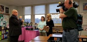 WHAM-TV reporter Jennifer Johnson interviews RSD Superintendent Antony McLetchie in the 5th grade classroom