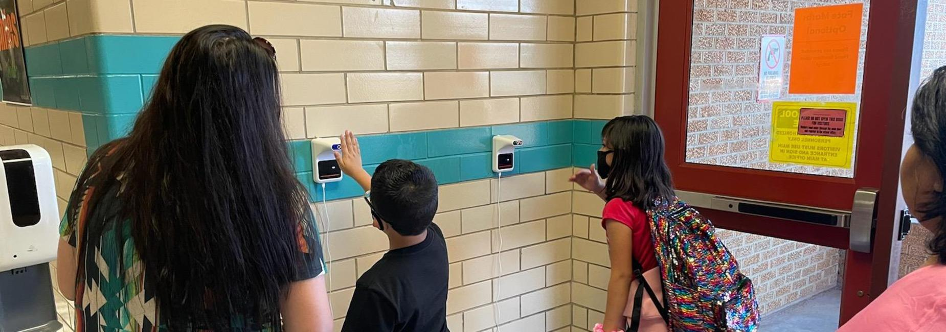 students checking temps