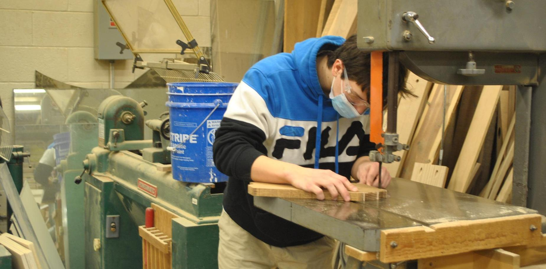 student working on wood project