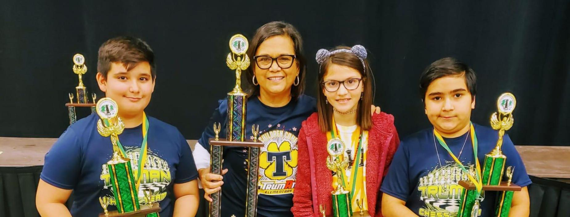 The Truman Chess Team poses with trophies.