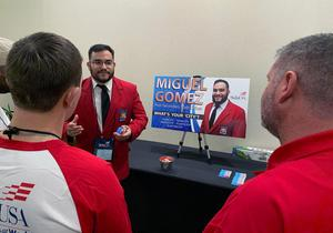 Miguel Gomez campaigns for state office.