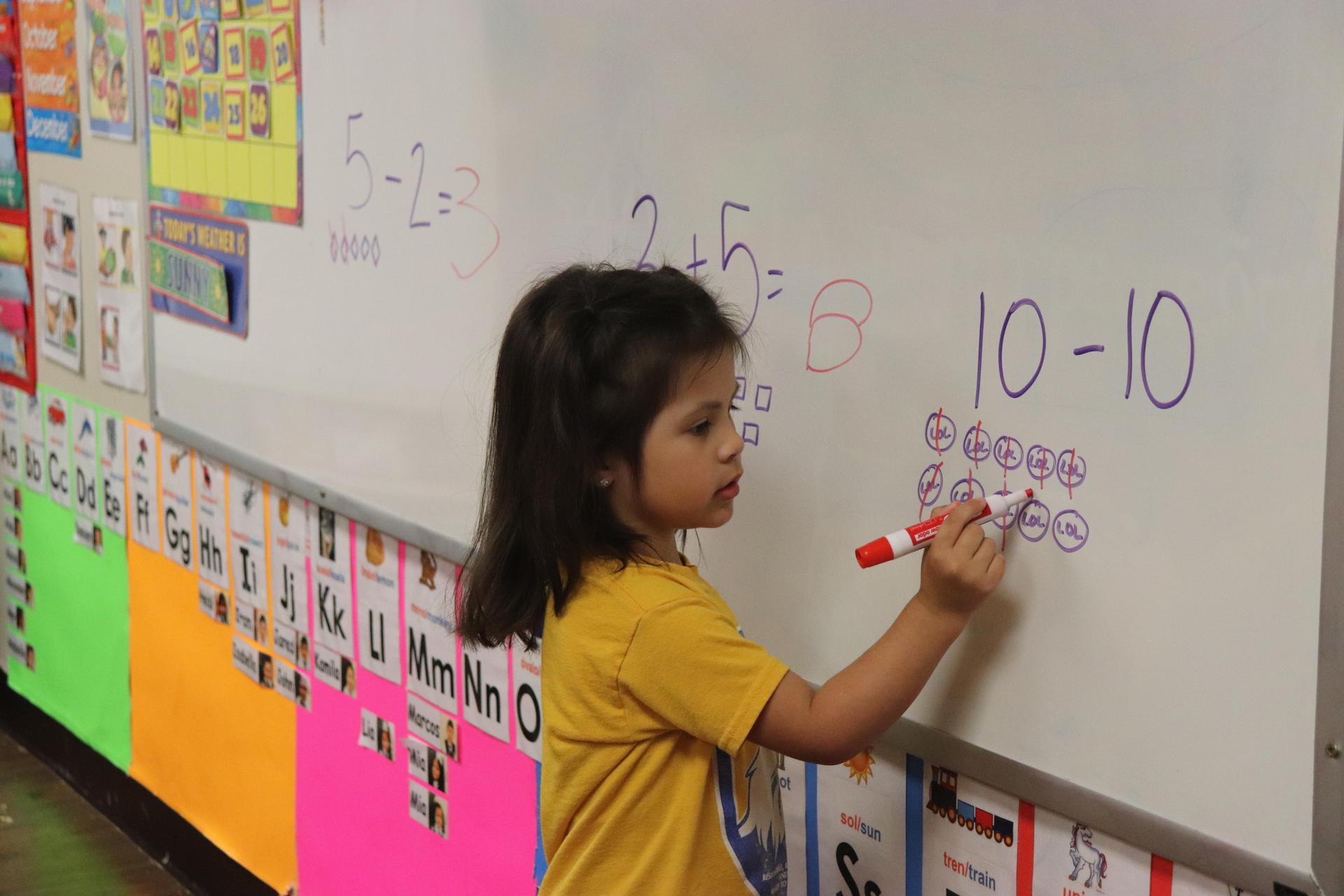 PreK student learning math problems