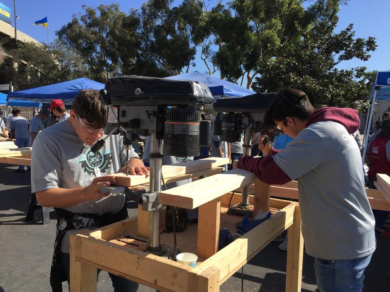 students building bunk beds