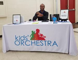 photo of the Baker Kids Orchestra organization table set up for information