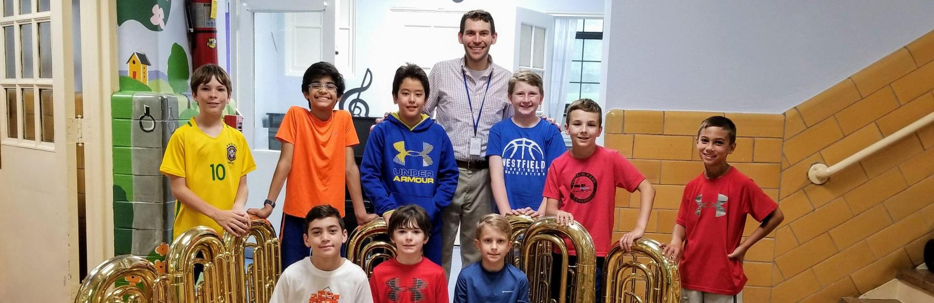 Photo of Franklin School tuba players with their tuba playing music director.