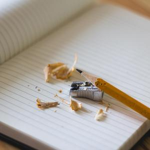 Pencil and sharpener on a notepad