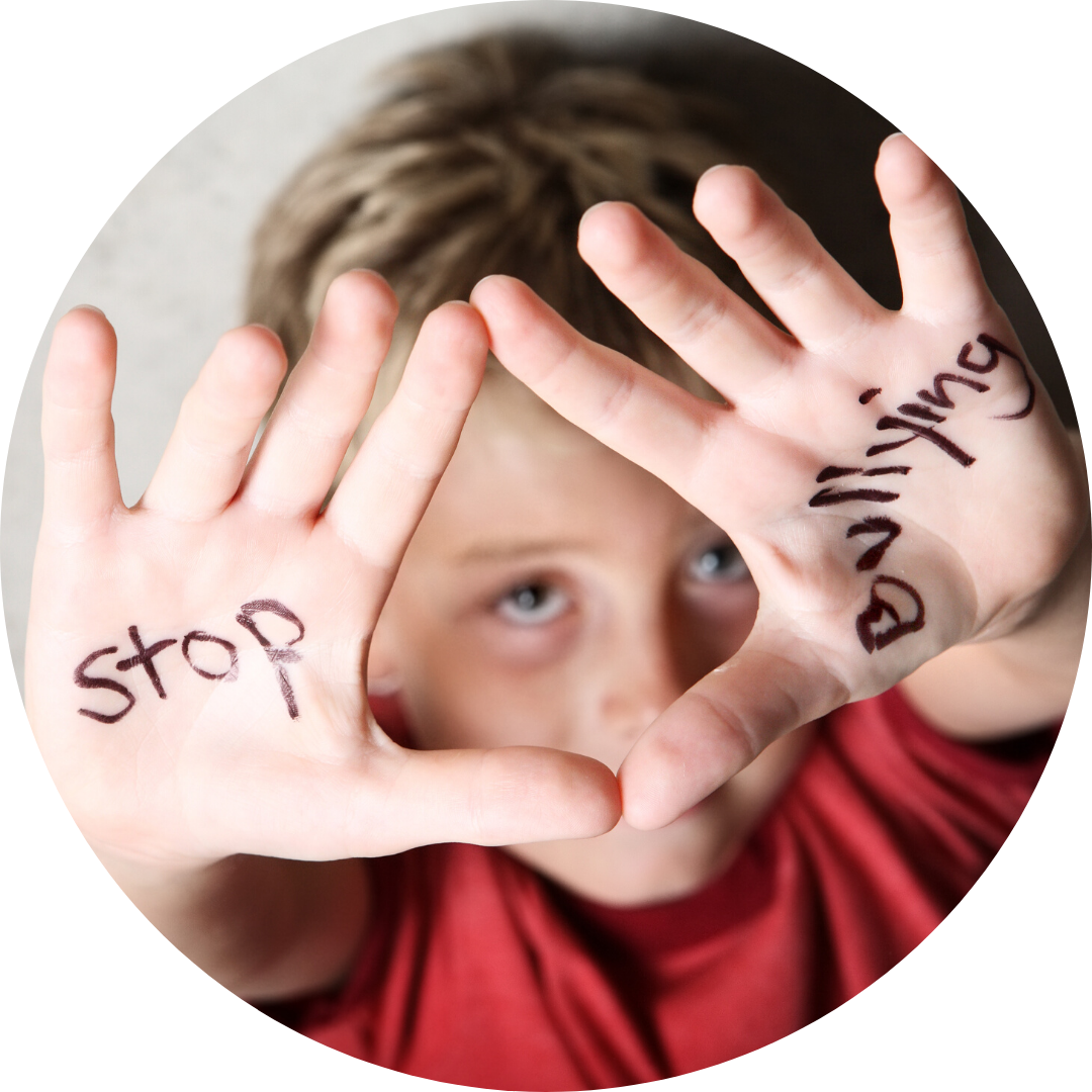 boy with stop bullying written on his palms