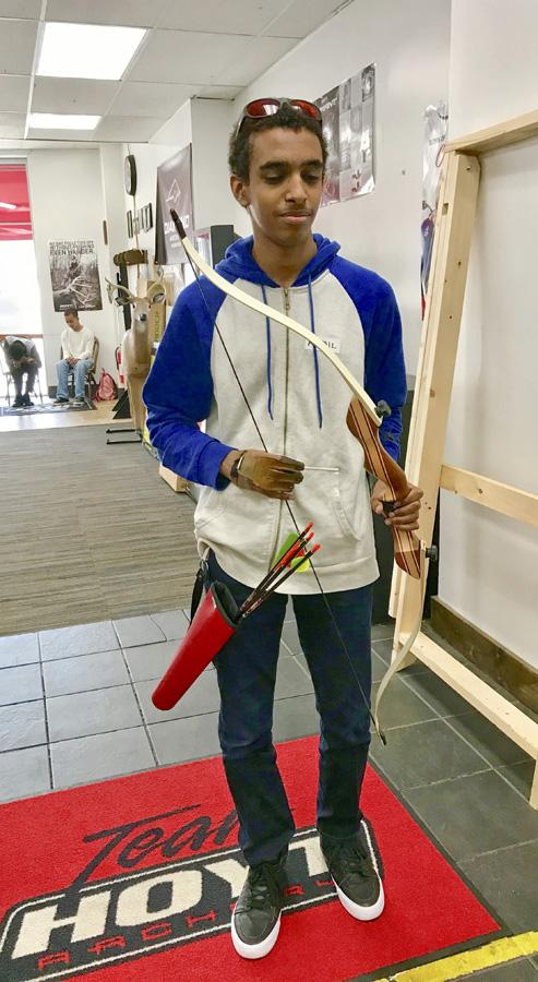 Image of student dressed with bow, quiver and glove.