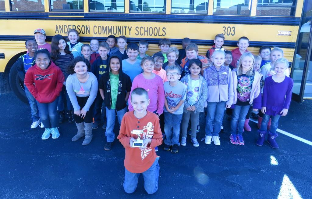 students standing next to school bus