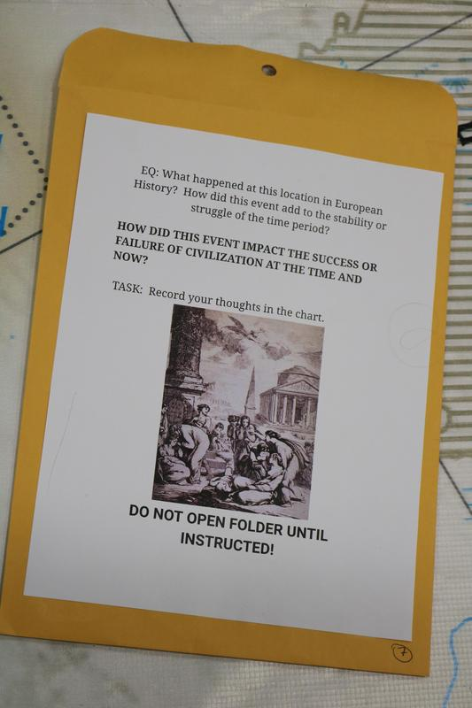 In a geo-scavenger hunt, of sorts, students used latitude and longitude to find an assigned location on the National Geographic Giant Map, set up in the schools' gymnasiums. Once at the location on the map, the students found an envelope with instructions on how to proceed with their lesson on European History.  Pictured here is the envelope with instructions on the lesson.