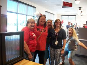 Staff members and families attend Chick-fil-A Night.