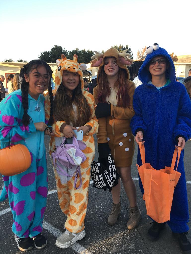 kids dressed as monster, giraffe, deer and cookie monster