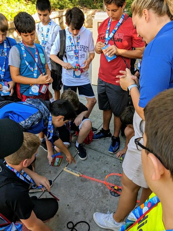 "During a STEM field trip to Florida for Edison 7th graders and their teachers, educational sessions at Disney World included determining the correct magnetic force needed to start a model of the park's ""Rock N Roller Coaster.""  'Once they solved the problem, they got to ride the actual ride,"" said mathematics teacher Ryan Belline."