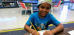 Kindergarten boy writing