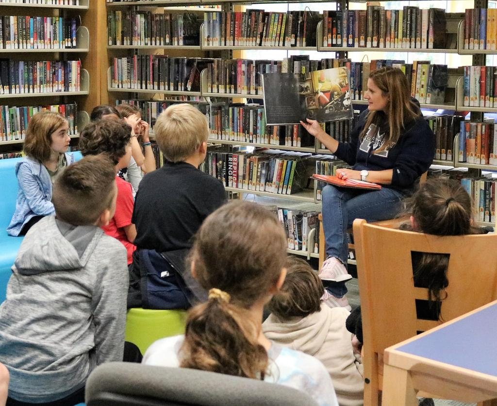 McKinley teacher reads to 3rd graders as they visit to Westfield Memorial Library during a walking tour of Westfield.