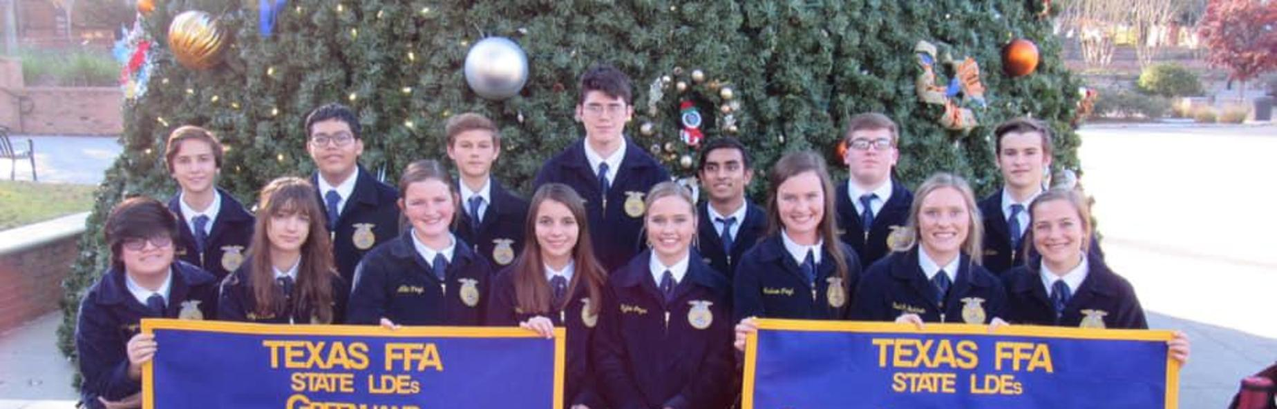 ffa students holding banners