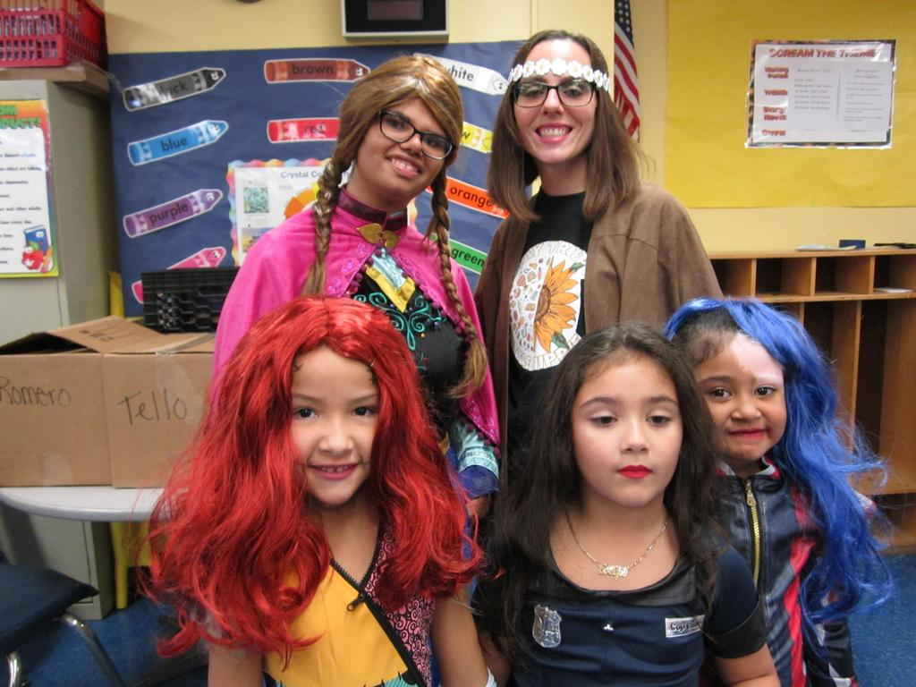 Ms. Viera as a flower child with a female student dressed as Elsa with three other kindergarten Elsa's