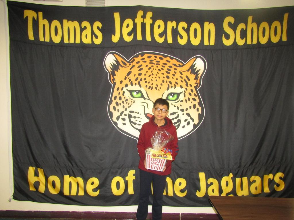 popcorn winner in front of the jefferson jaquar poster