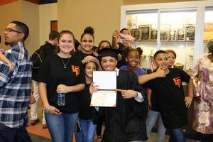 Graduate celebrating his diploma