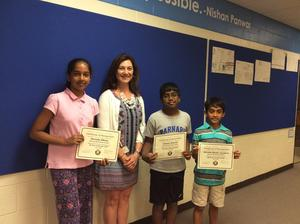 Principal with student winners