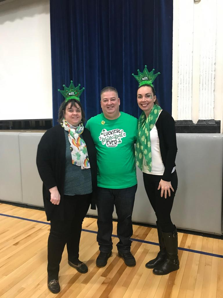 Mrs. Perez, Mr. Rivera, Ms. Powers dressed in green gear