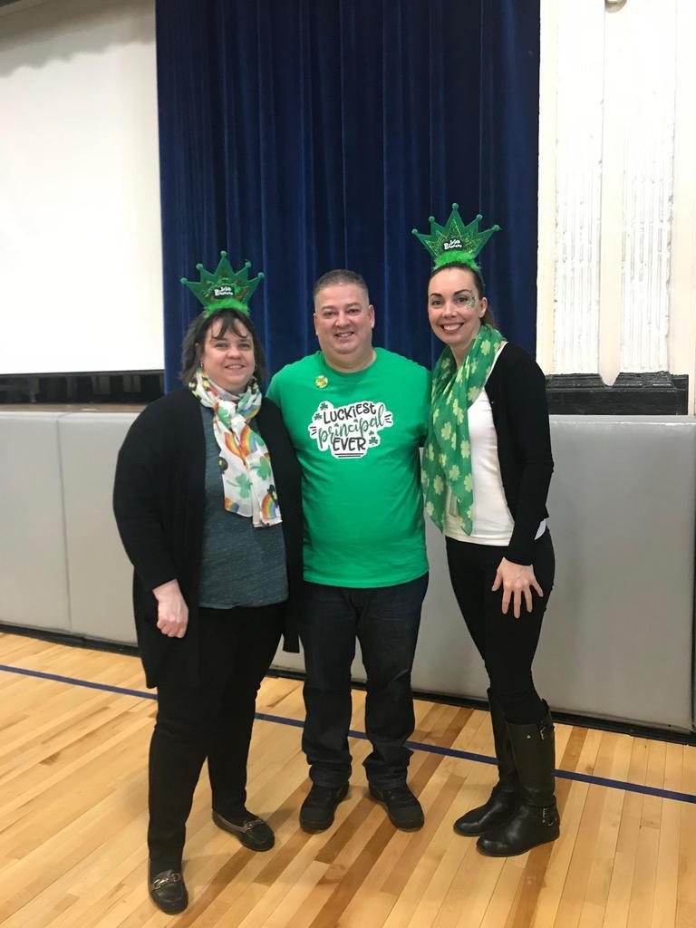 Mrs. Perez, Mr. Rivera, Ms. Powers dressed in green gear