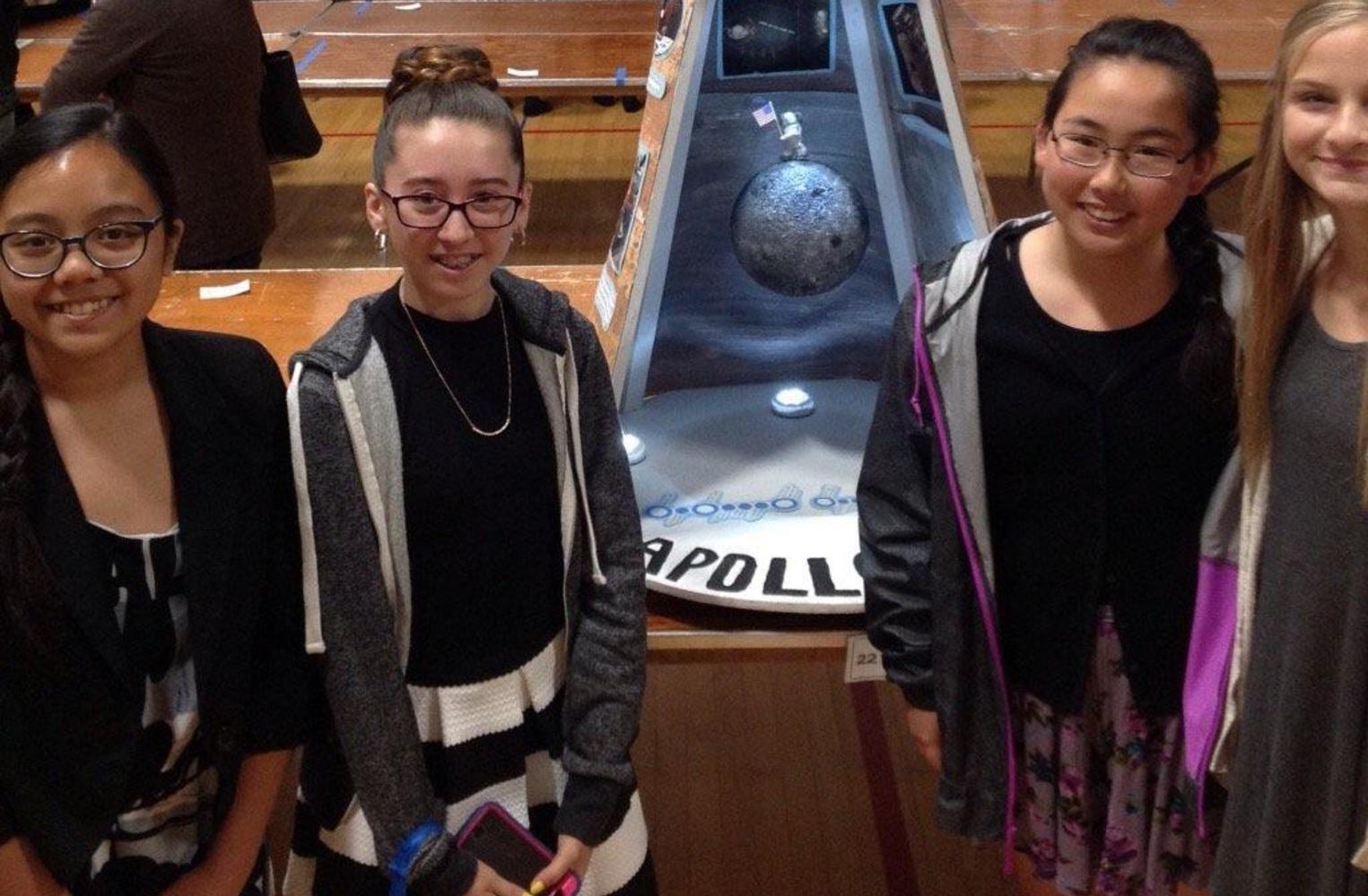 students with Apollo display