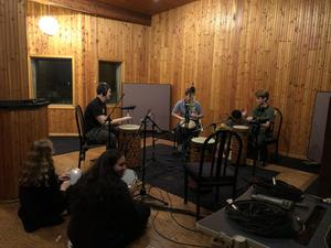 Pic of students recording music at Tonic Studios