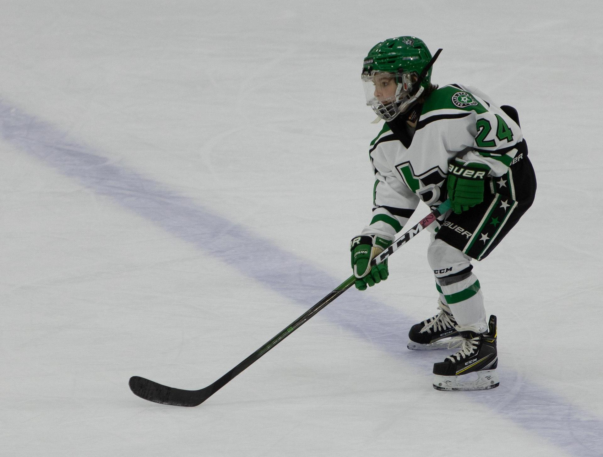 Student Playing Hockey
